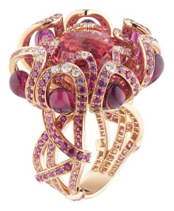 Ring in pink gold, rubies, pink sapphires, diamonds, drops of red tourmaline, set with one 8.61 carat round faceted checkerboard central pink tourmaline.
