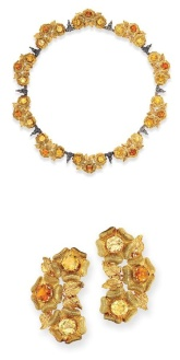 Gold and Citrine Necklace and Pair of Earclips, Mario Buccellati 18 kt., composed of ten triads of textured gold flowers, each flower centering a round orange citrine, flanked by 2 round yellow citrines, accented by textured gold leaves with rose gold veins, spaced by stylized white gold leaves, the earclips of similar design, approximately 70 dwt. Length 16 3/4 inches.