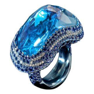 Wallace Chan Blue Fantasy ring. The ring features a mesmerising 53.78ct blue topaz, surrounded by white diamonds and sapphires that follow the shape of the stone.