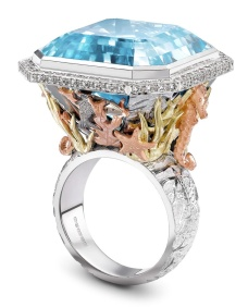 The Theo Fennell Under the Sea ring features finely detailed fish, seahorses and coral around a 44.87ct Blue Topaz. The Topaz is incredible clear and beautifully mimics the depth of the sea.