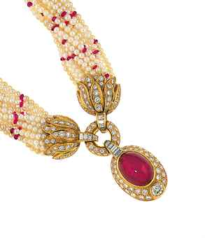 A cultured pearl, ruby and diamond torsade necklace, by Adler The multiple cultured pearl strands interspersed with ruby bead spacers with diamond-set foliate terminals, suspending a cabochon ruby drop within a pavé-set bombé diamond surround with single oval-cut diamond collet, to a baguette-cut diamond loop and diamond-set circlet surmount, 42.0cm long Signed Adler. Estimate £ 2,000-2,500.