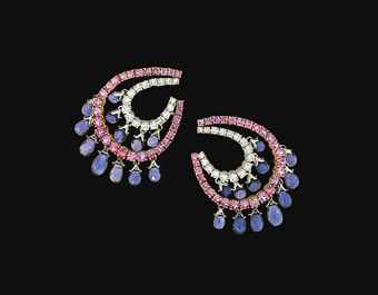 A pair of iolite, pink sapphire and diamond earrings Each designed as a graduated brilliant-cut diamond loop within a graduated pink sapphire loop suspending pear-shaped iolite drop fringes, post and clip fittings, 5.0cm long. Estimate £ 1,300-1,600.