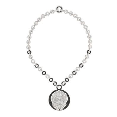 "Les Intemporels de Chanel Lion Talisman Necklace. ""Lion Talisman"" necklace in 18K white gold set with 801 brilliant-cut diamonds for a total weight of 7.9 carats and 378 brilliant-cut black diamonds for a total weight of 5.6 carats."