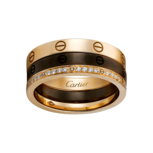Three rings: one 18K pink gold, one brown ceramic, and one 18K pink gold ring set with diamonds.