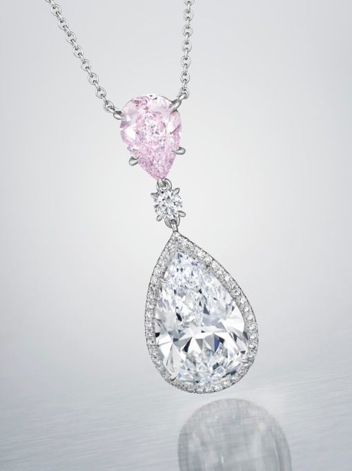 A PEAR-SHAPED D-COLOR DIAMOND OF 5.06 CARATS AND A PEAR-SHAPED FANCY PURPLISH PINK DIAMOND OF 1.68 CARATS PENDANT NECKLACE ESTIMATE: $280,000 – $350,000