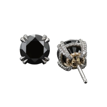 A pair of 4.89 carat black Diamond studs set with 18-karat white gold, complimented by Alexandra Mor signature details of 1mm knife-edged wire and 0.40 carats of 'floating' Diamond melee. 5.29 carats total Diamond weight. 18-karat white gold set on an 18-karat yellow gold AM logo gallery. Signed by artist. Crafted in the USA. Limited-Edition 1/50