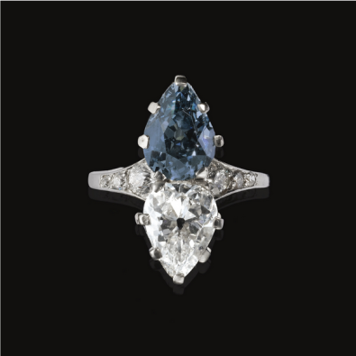 Set with a fancy deep greyish blue pear-shaped diamond weighing 2.89 carats and a colourless pear-shaped diamond weighing 2.34 carats, the shank set with rose, single and circular-cut stones, mounted in platinum.