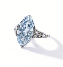 The modified marquise-shaped diamond of fancy blue color weighing 3.54 carats, within a delicate mounting set with old European-cut and single-cut diamonds weighing approximately .35 carat. Circa 1900.