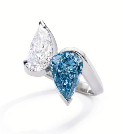 The magnificent pear-shaped Fancy Vivid Blue, Internally Flawless diamond weighing 5.35 carats matched with a pear-shaped D color, Internally Flawless diamond of 5.42 carats.