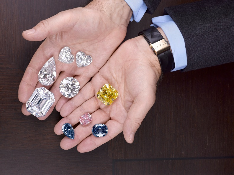 Laurence Graff holds a selection of the world's most valuable gemstones.
