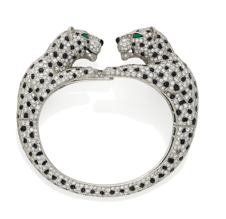 "A diamond and onyx ""double-panther"" bracelet, by Cartier. Estimate: US$408,250 - $612,375."