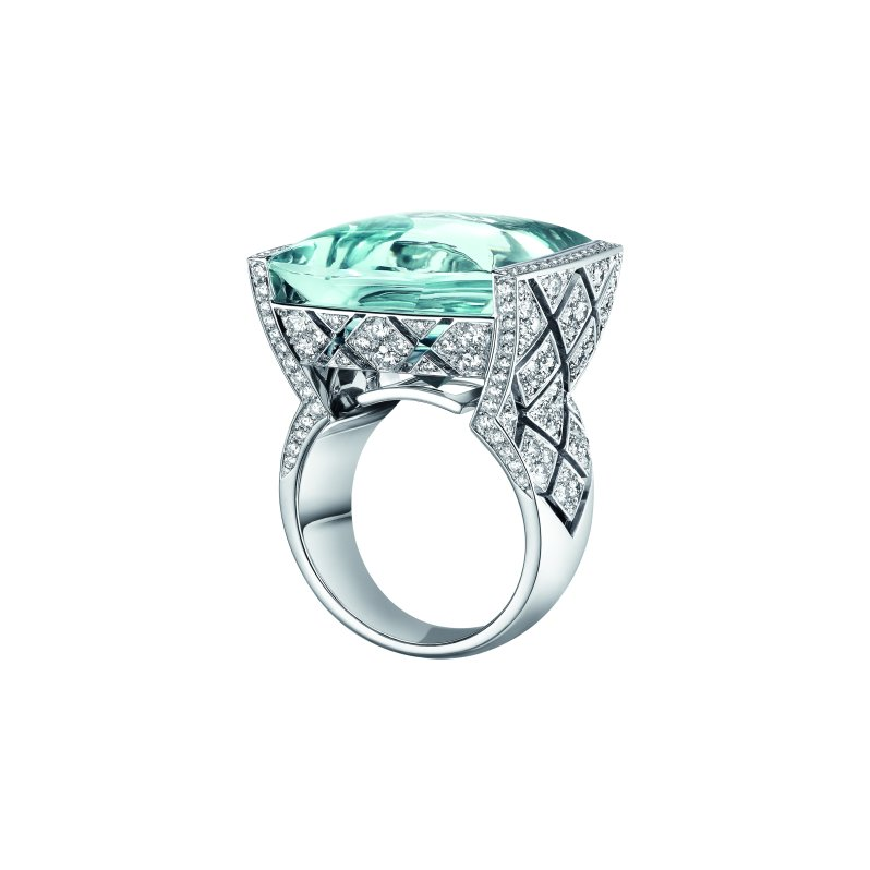"""Signature Acidulée"" ring in 18K white gold set with a 23-carat cabochon-cut aquamarine and 216 brilliant-cut diamonds for a total weight of 2.1 carats."