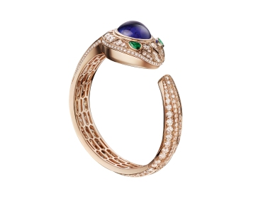 Bulgari Serpenti Seduttori. High Jewellery bangle watch, 18kt rose gold curved case set with brilliant-cut diamonds, 1 cabochon cut tanzanite and 2 pear-shaped emeralds; 18kt pink gold dial and bracelet set with brilliant-cut diamonds.
