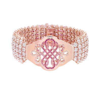 Van Cleef & Arpels - Le Secret High Jewellery Collection. Coeurs Enlacés Bracelet. Pink gold, diamonds, pink and yellow sapphires, rubies, spessartite garnets, 3 cushion-cut pink spinels for a total of 31.17 carats. Detachable clips. Open work detail